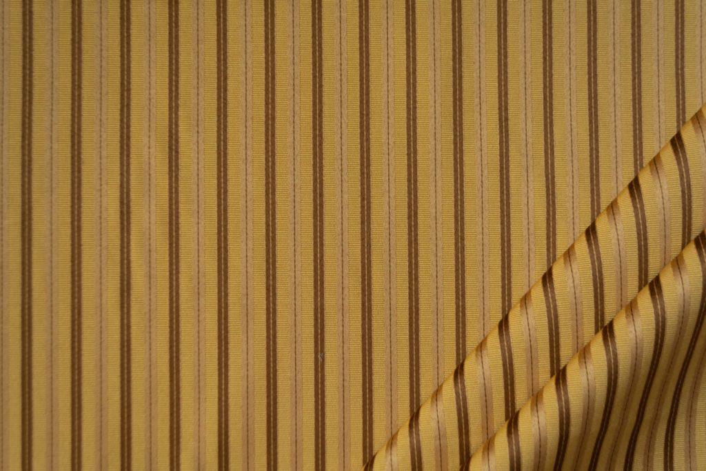tessuto elegante riga piccola mx supreme colore oro antico e marrone