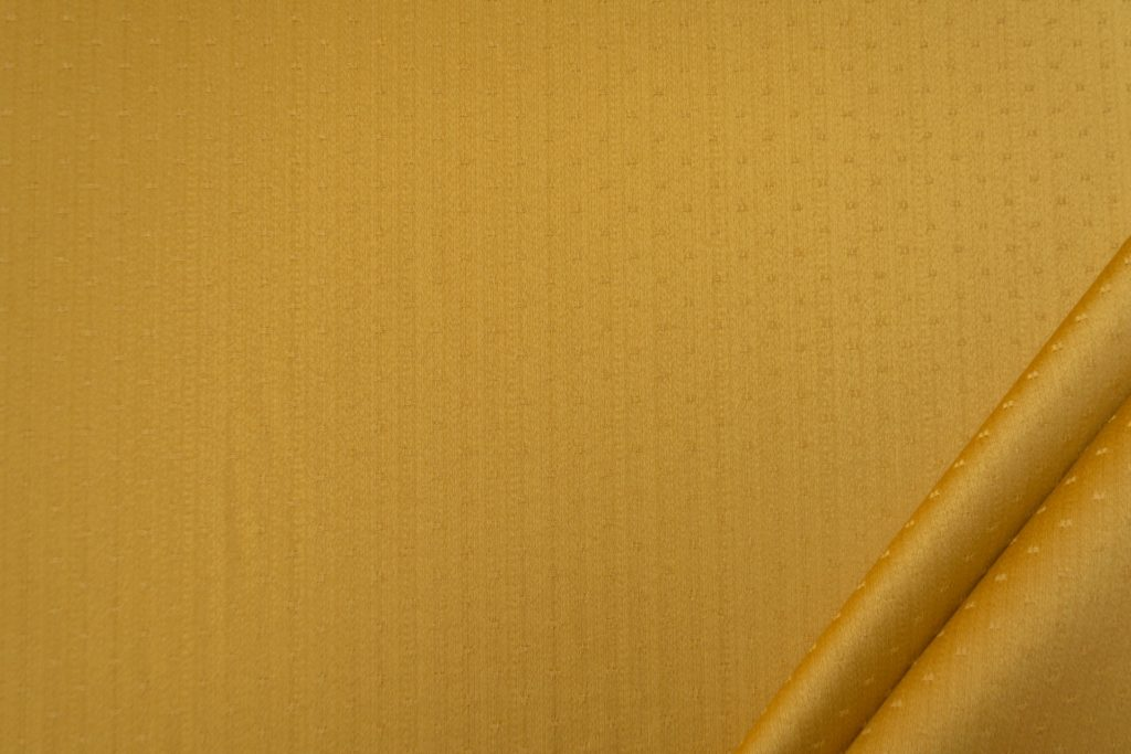 tessuto rasato ignifugo classe 1 elegante con puntino mx metropolis colore oro
